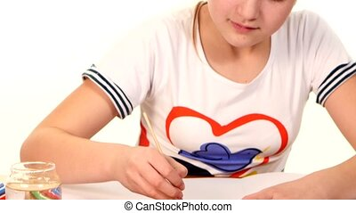 Beautiful girl paints color a stripes paper on white background