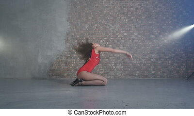 Beautiful girl passionately dancing