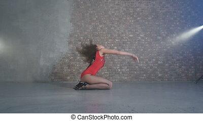 Beautiful girl passionately dancing