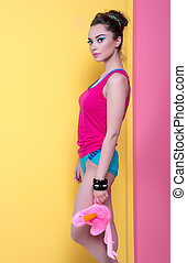 Girl in bright clothes on a colored background, retro style.