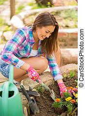Beautiful Girl Planting Flowers