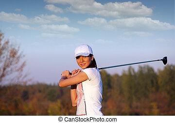 beautiful girl play golf
