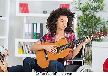 beautiful girl play music with guitar