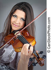 beautiful girl playing violin