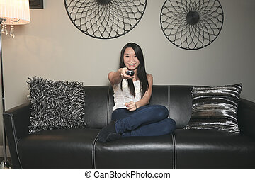 beautiful girl portrait sitting in the sofa of a living room
