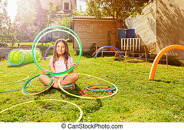 Beautiful girl portrait with hoops on playground
