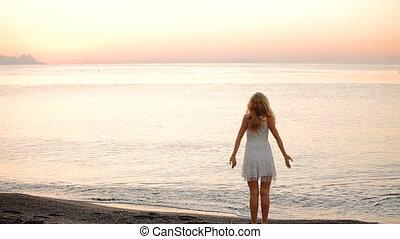 beautiful girl posing at sunset