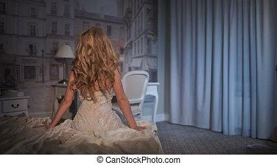 Beautiful girl posing in bed studio