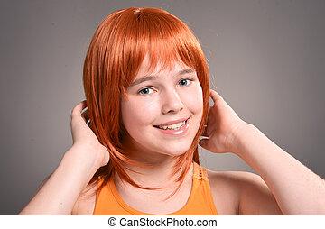 Beautiful girl posing in studio on background