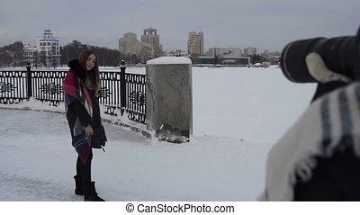 Beautiful girl posing in the street in winter