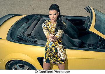Beautiful girl posing near sport car