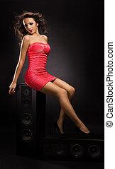 Beautiful Girl Posing Seductively on Speaker - Girl in red...