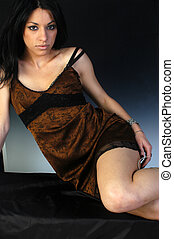 Beautiful girl posing with a brown dress