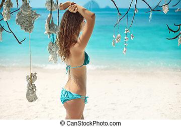 Beautiful girl relaxing on the tropical beach