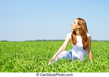 Beautiful girl resting on the field