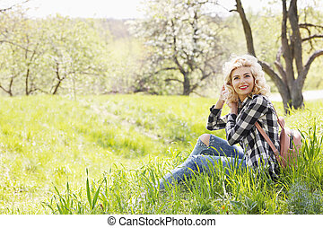 Beautiful girl resting on the grass