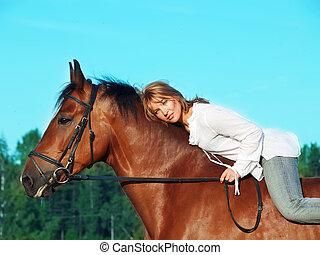 beautiful girl riding on horse