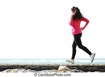 beautiful girl running on the beach