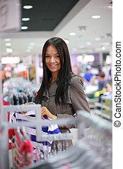 Beautiful girl shopping in a store