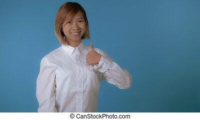 beautiful girl shows hand gesture ok