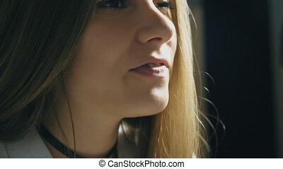 Beautiful girl sings in sound studio. Attractive lady emotionally sings song. Working of creative musician. Show business concept. Slow motion Close up