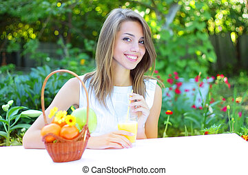 Beautiful girl sitting at the table