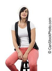 beautiful girl sitting on a stool