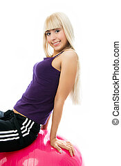 beautiful girl sitting on the fitness ball
