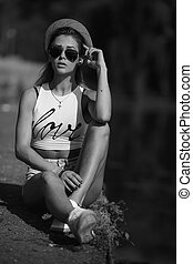 beautiful girl sitting on the pier