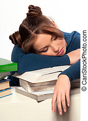 girl sleeping on a stack of books