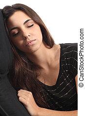 Beautiful girl sleeping on a coach