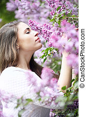 beautiful Girl smelling a lilac