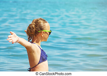 beautiful girl smile with raised hands, woman on beach summer vacation. concept of freedom travel.