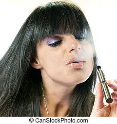 beautiful girl smoking electronic cigarette - brunette...