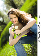 beautiful girl snowdrop bouquet in forest