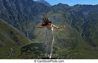 beautiful girl standing on mountain background