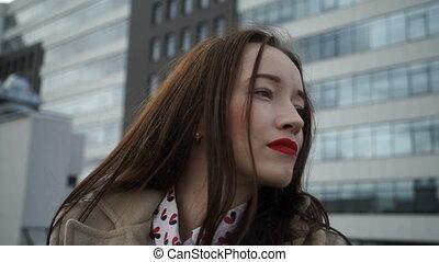 Beautiful girl standing on the street