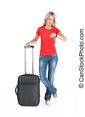 beautiful girl standing with luggage and waiting. young girl looking at time on white background