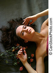 Beautiful girl - The image of the beautiful girl laying on a...