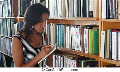 beautiful girl student in the library 3