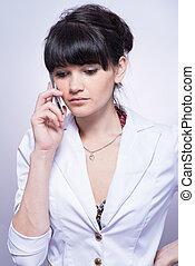 Beautiful girl talking on the phone