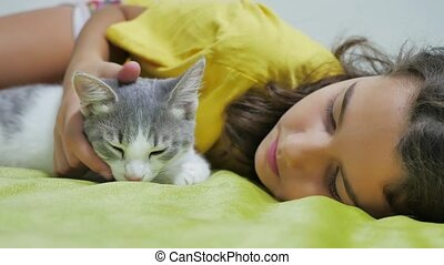 Beautiful girl teen and cat. girl cat friendship playing on...