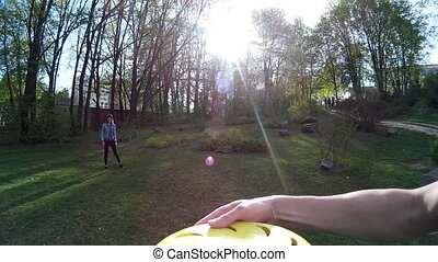 Beautiful girl throwing frisbee in a park 1