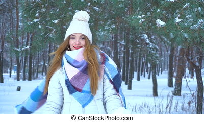 beautiful girl throws snow and smile
