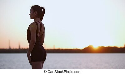 Beautiful Girl Trains Her Back Before Running Near The...