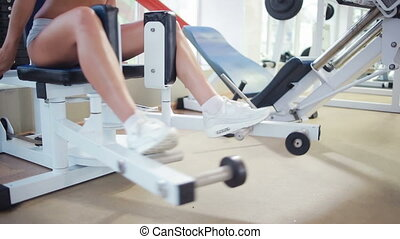 Beautiful girl trains in the gym. racing simulator. fitness...