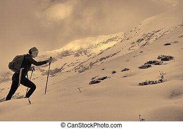 beautiful girl trekking on the mountain