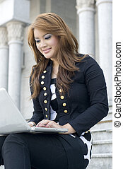 Beautiful girl typing on notebook