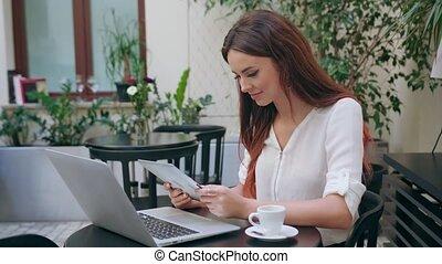 Beautiful Girl Using an iPad in the Room