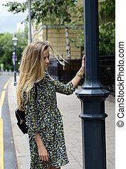 beautiful girl walking in a summer city